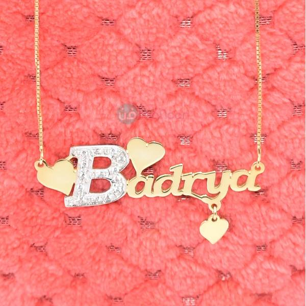 Name Necklace decorated with three soft hearts and begins with a silver letter